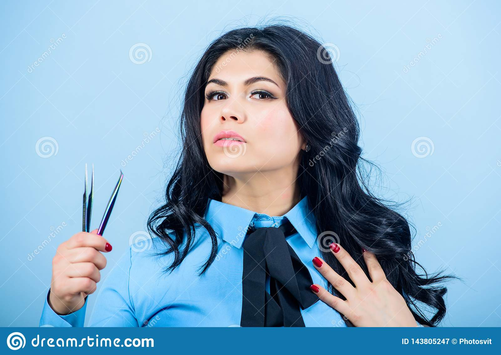 Professional makeup artist. Cosmetic tweezer tool. Beauty shop concept. Makeup false lashes volume. Lash applicator