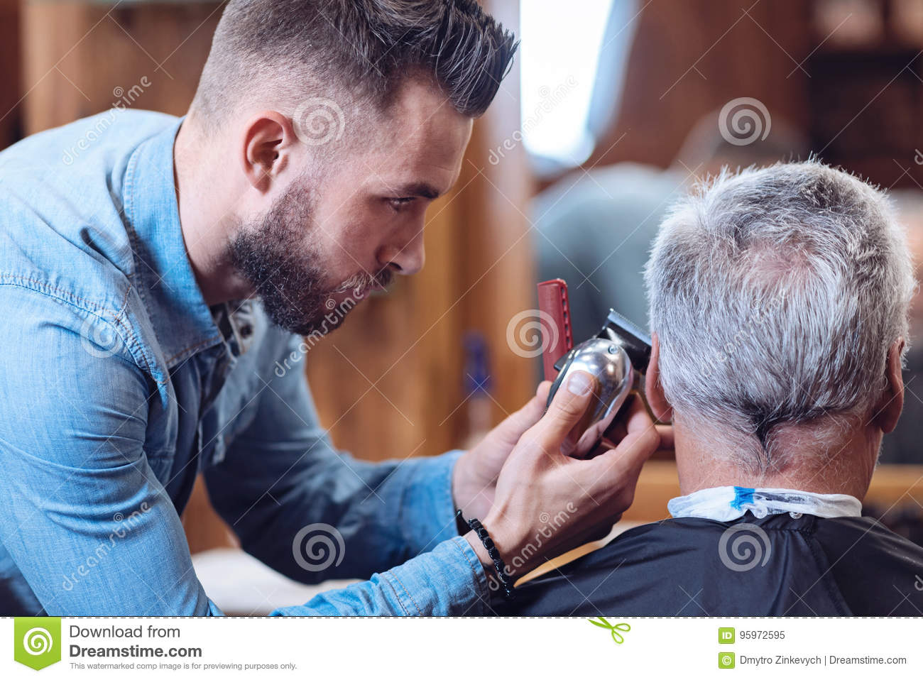 Professional Male Barber Holding A Hair Cutting Machine Stock Image