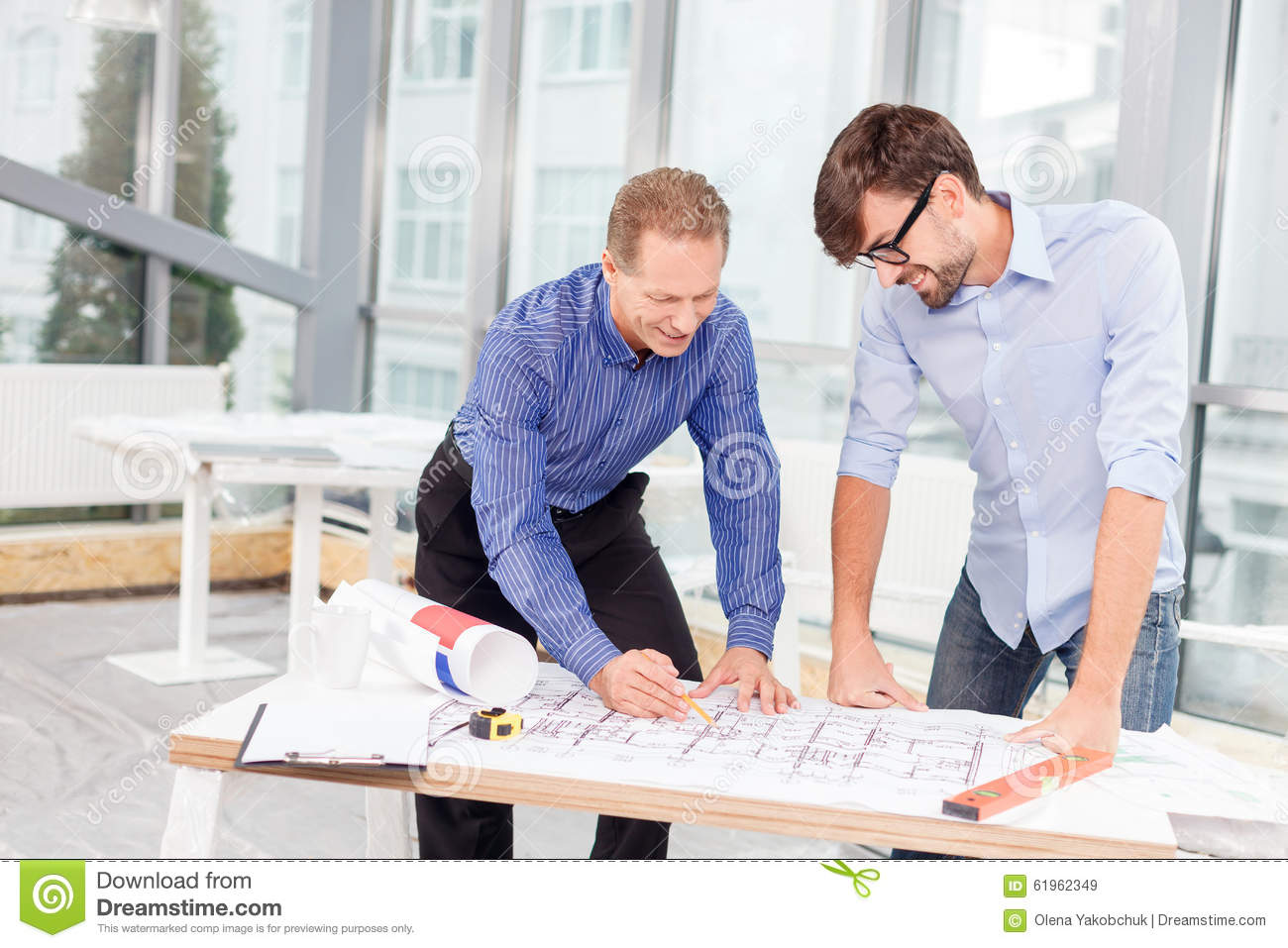 Professional Male Engineers Are Discussing New Stock Photo