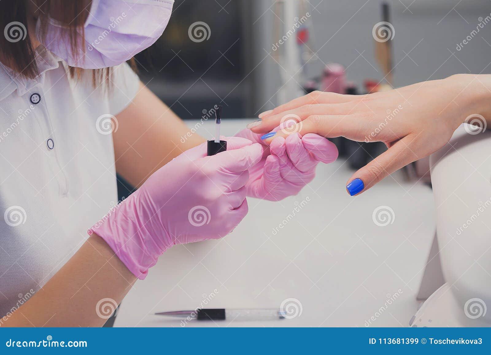 Professional Manicure Process In Beauty Salon Closeup Manicurist
