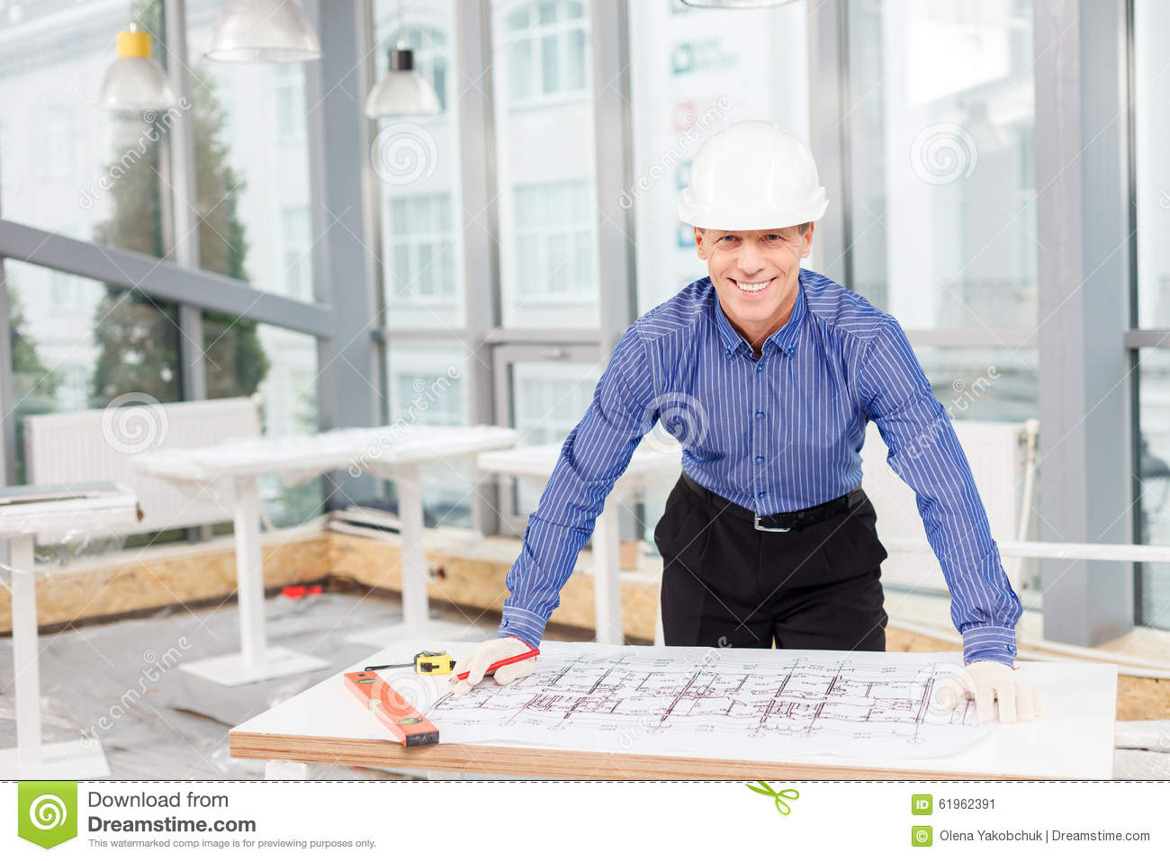 Professional mature architect is designing new stock photo for Professional architect