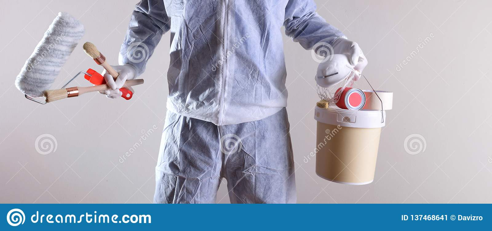 Professional painter with paint and tools and work protections background