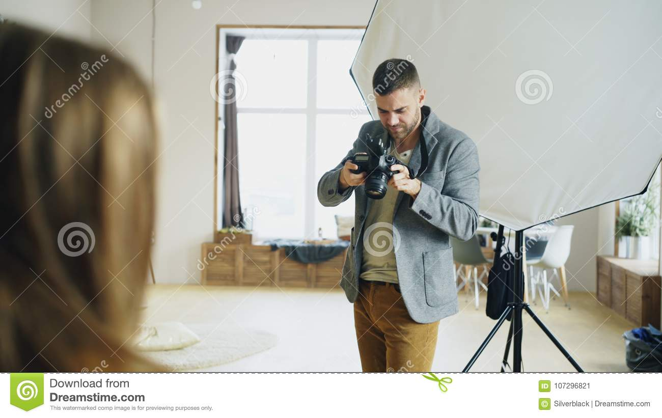 Professional Photographer Taking Photos Of Model On Digital Camera Working Cameras In Photo Studio