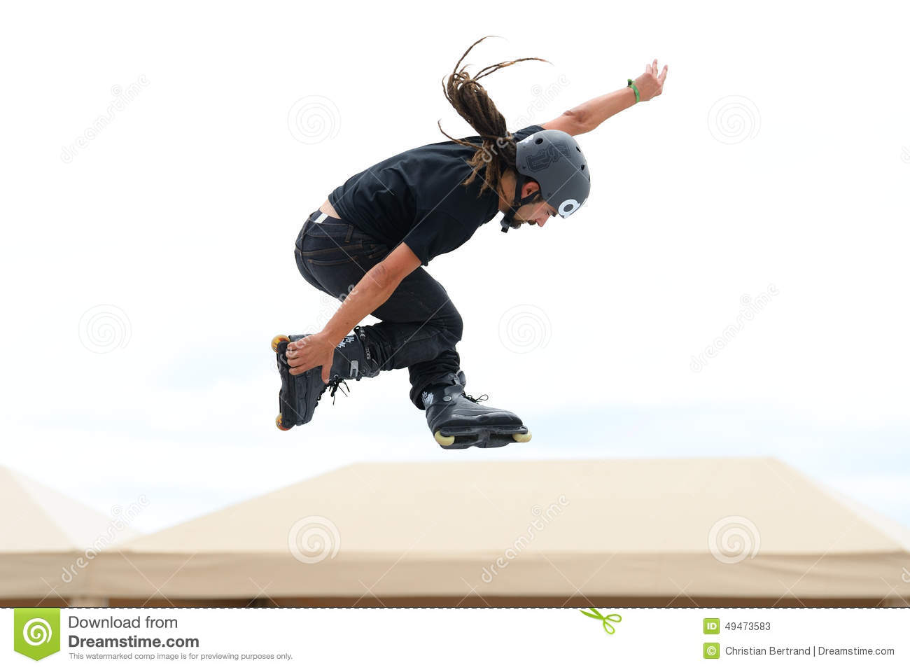 A Professional Skater At The Inline Skating Jumps Competition At