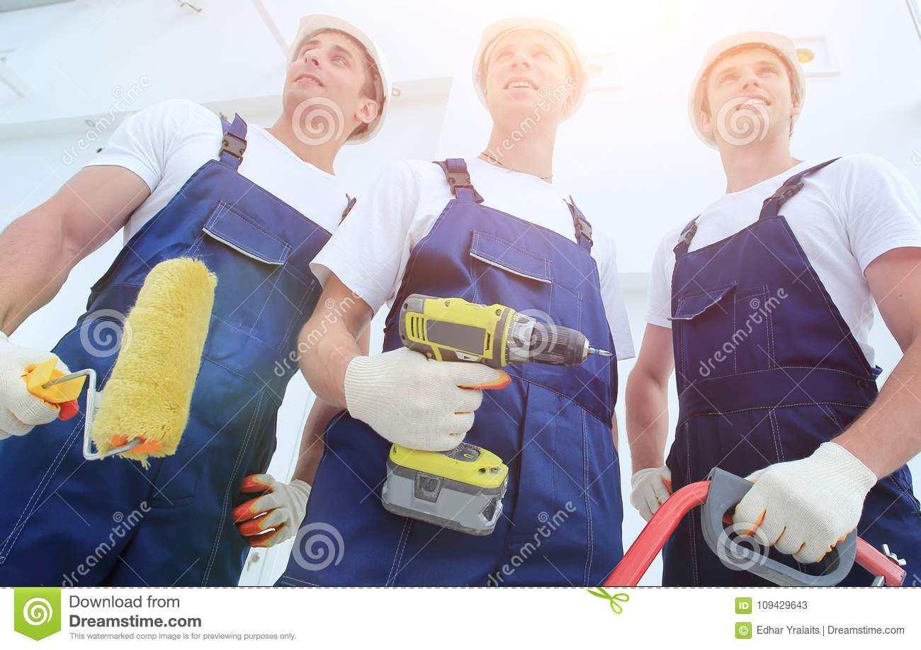 Professional team of builders with tools