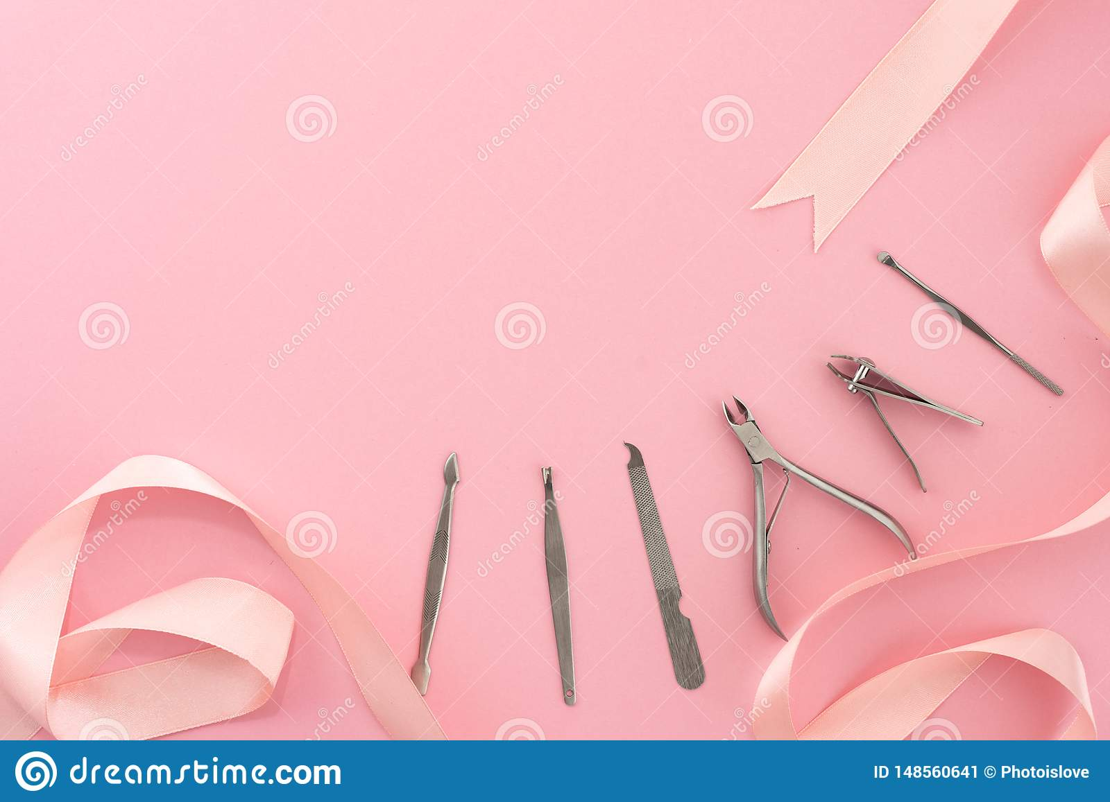 Professional Tools Of Manicure Set For Nail Care On A Pink Background With A Bow Beauty Concept