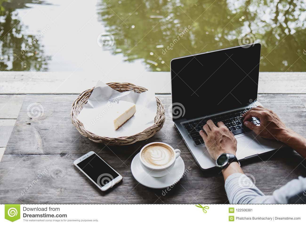 Professional web designer using laptop with mock up screen for c