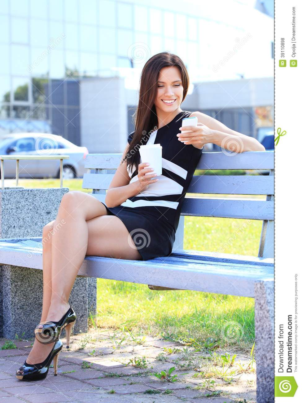 Professional woman drinking coffee in a park