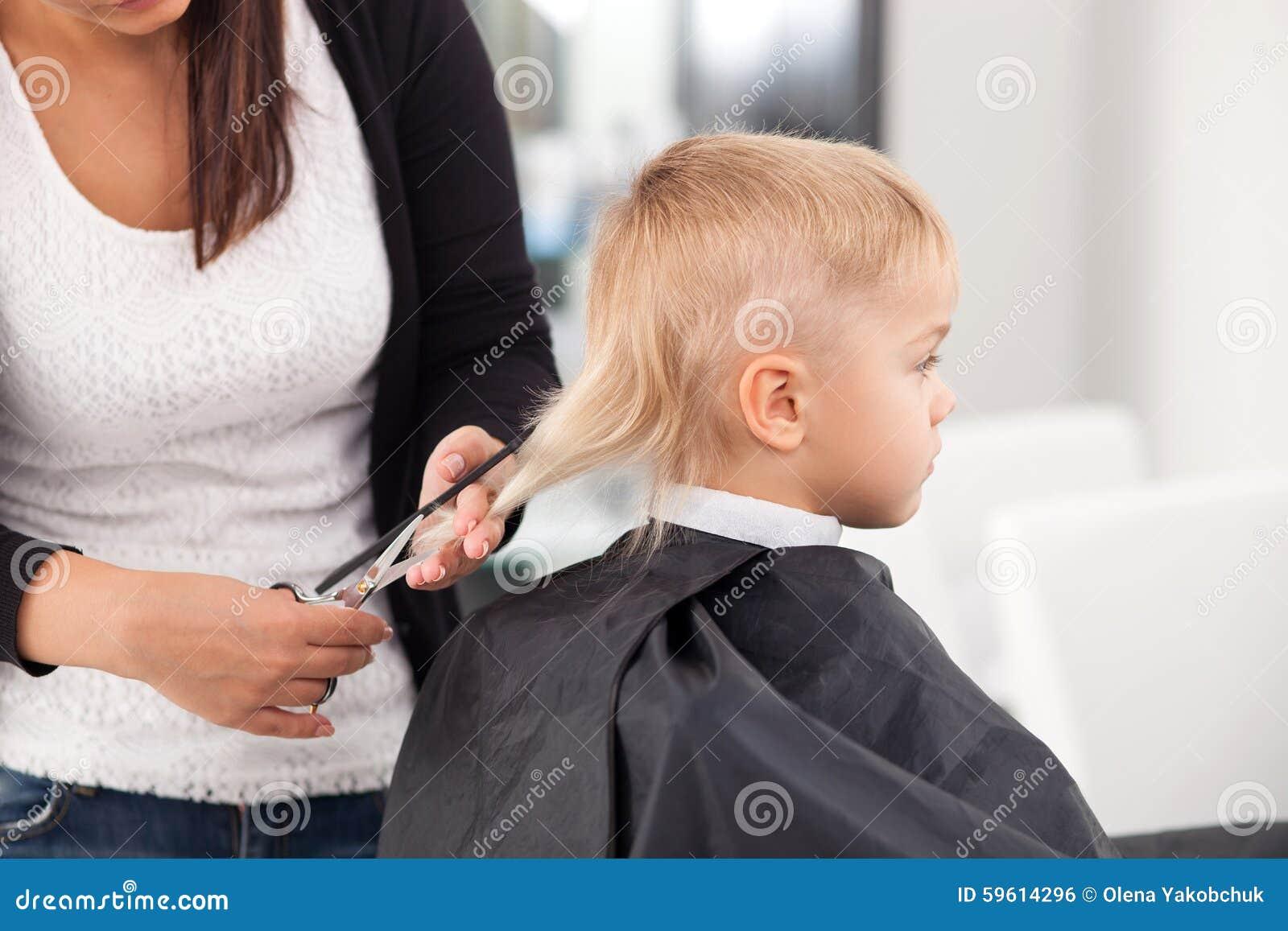 Professional Young Hairdresser Is iCuttingi iHairi Of Stock