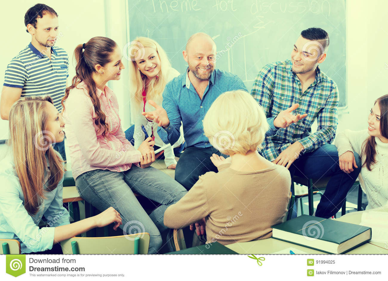 Professor consulting different age students