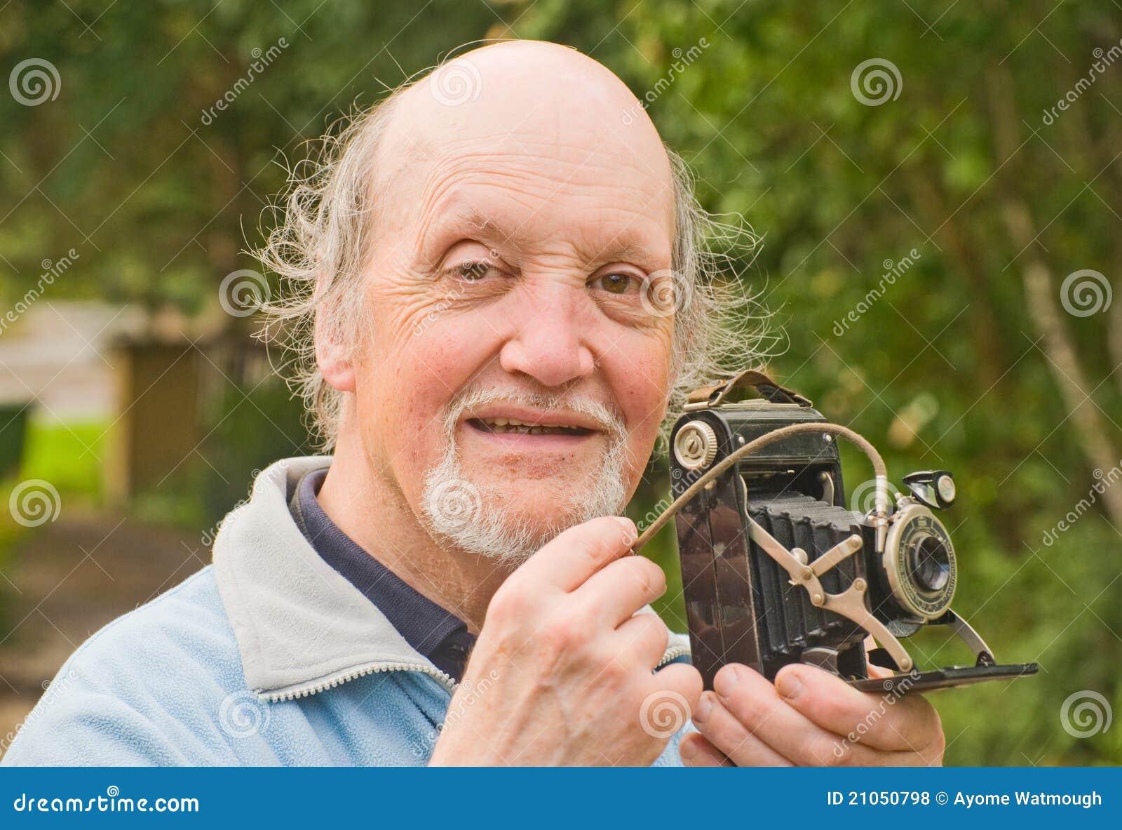 Professor with retro camera .