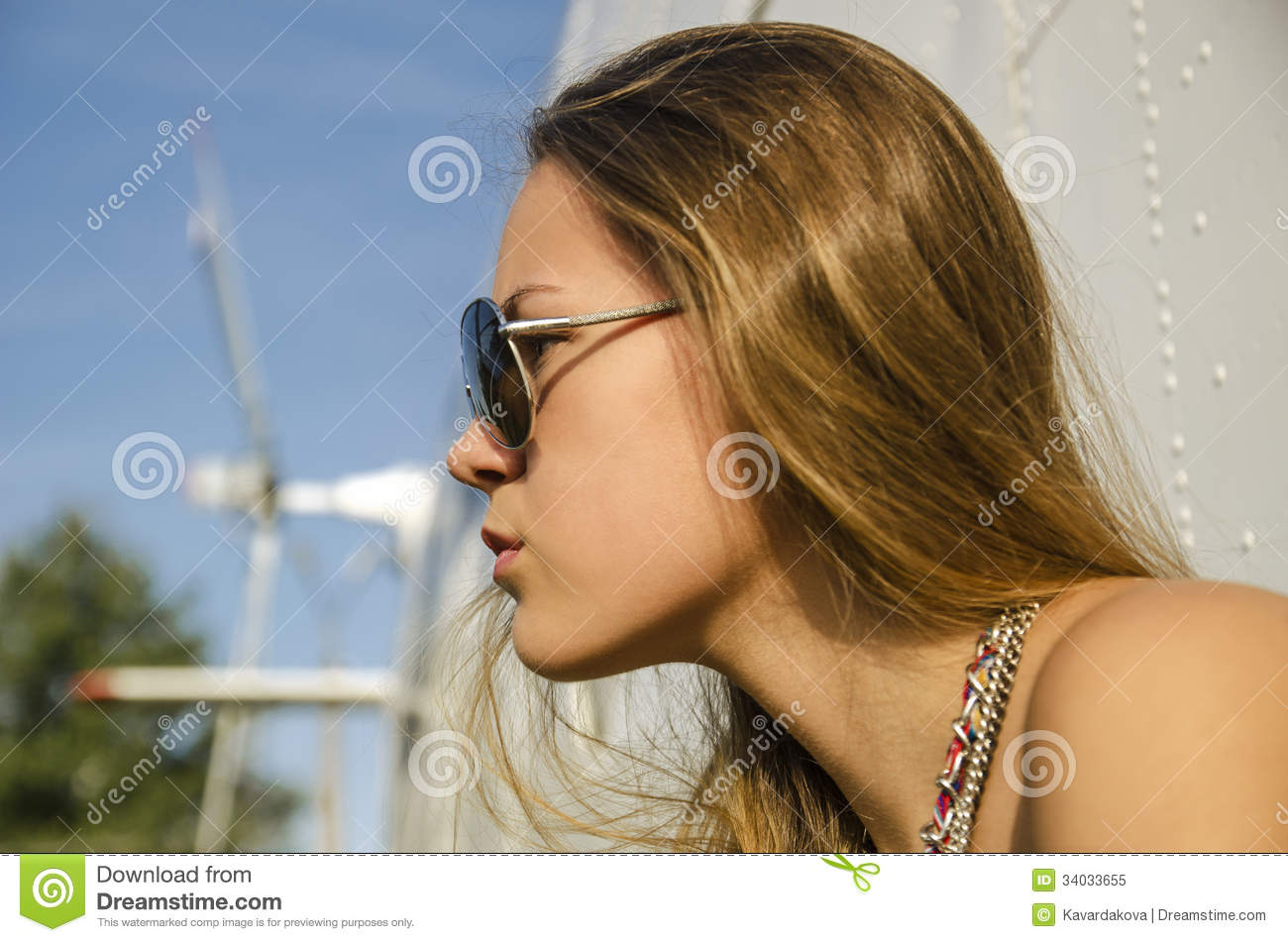 profile attractive girl with long hair in sunglasses about