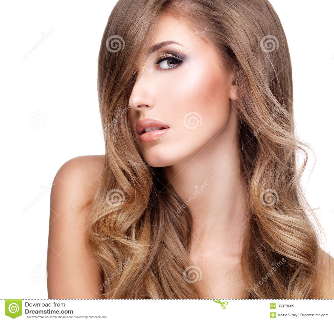 Profile of a beautiful woman with long wavy hair