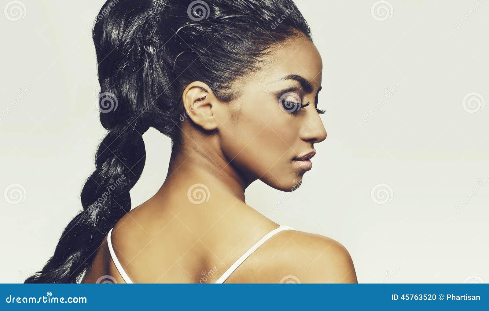Profile of beautiful young woman braids