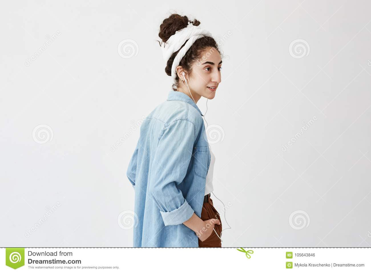 Profile Of Female Teenager Listening To Music Or Audio Book