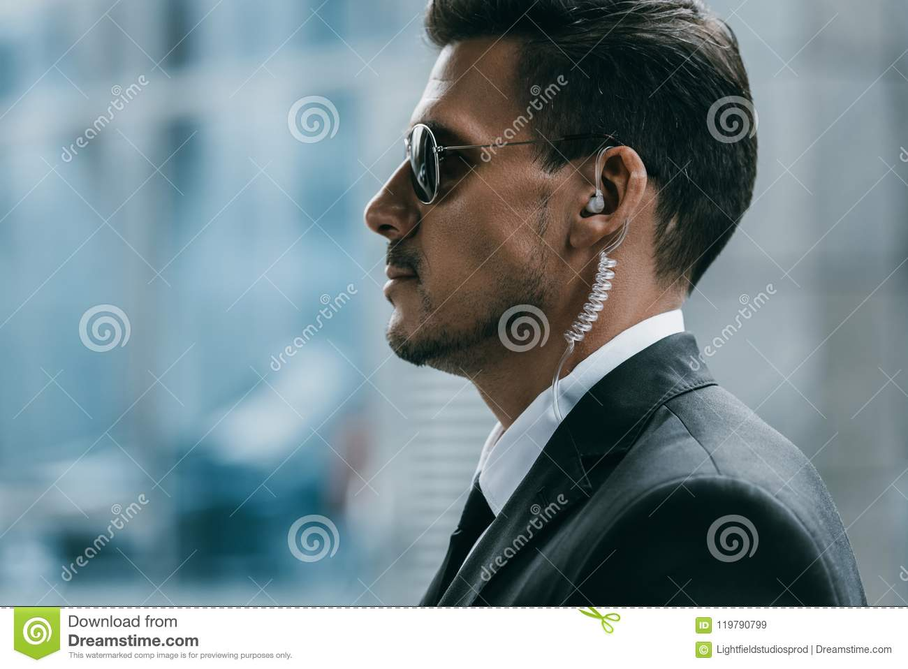 profile of handsome security guard with sunglasses