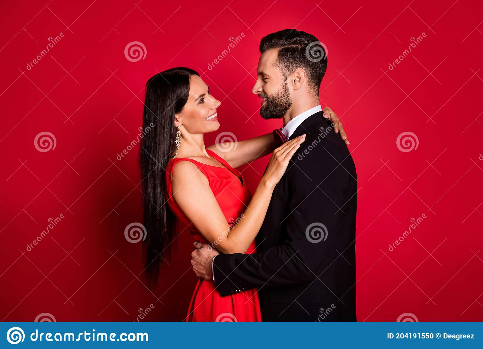 Profile Photo Of Optimistic Cute Couple Dance Wear Suit Dress Isolated On Red Color Background Stock Photo Image Of Love Brunet 204191550