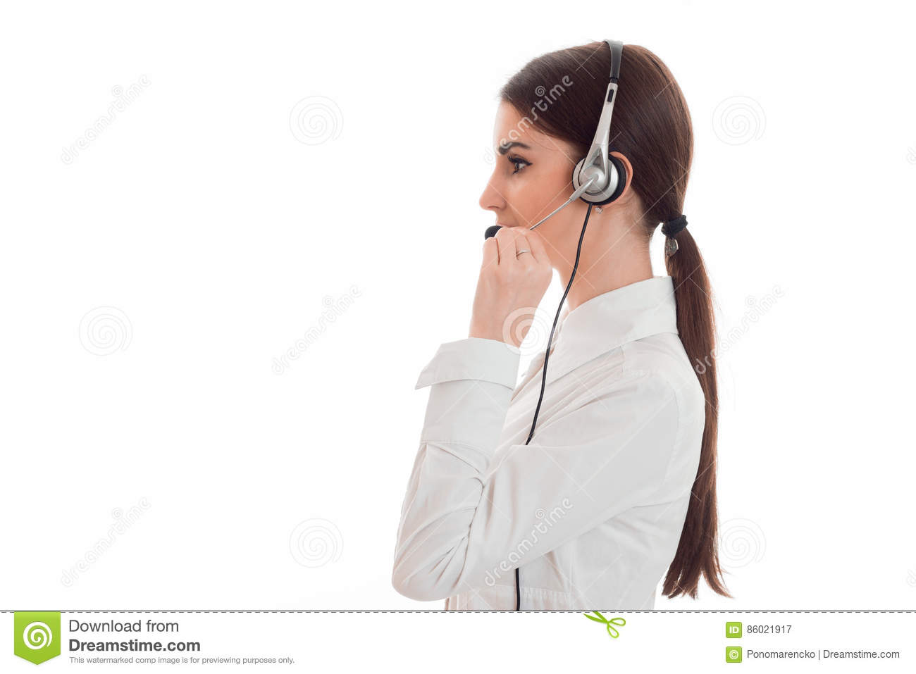 Profile portrait of pretty young brunette call office worker woman with headphones and microphone isolated on white