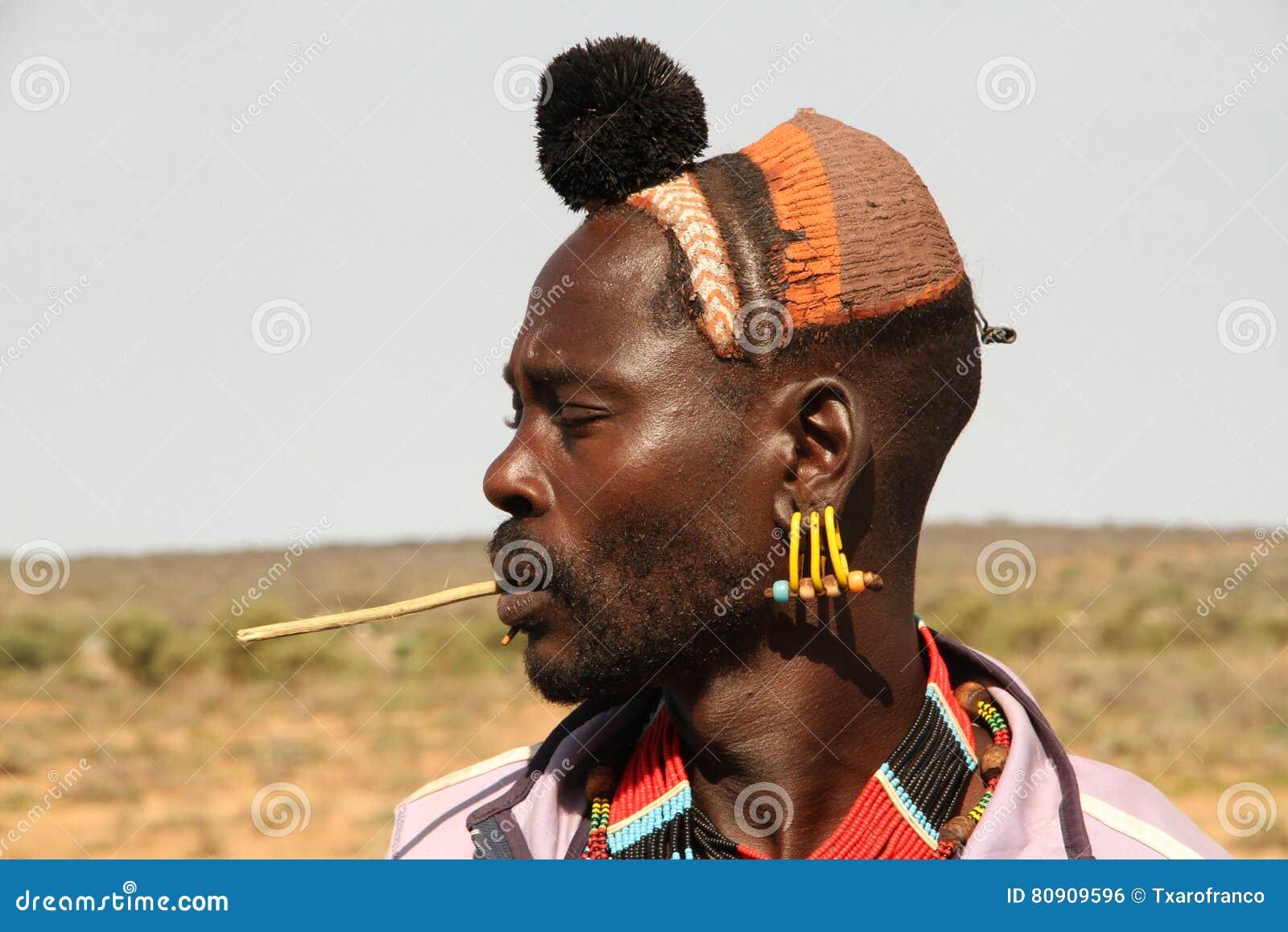 Profile portrait of a young male of the hamer ethnicity in Turmi