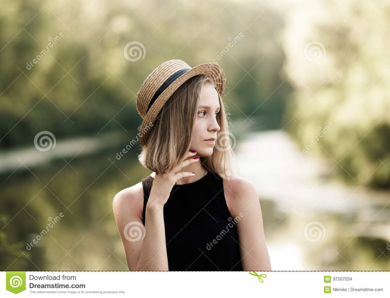 d2bff3d65f4 Profile Of A Pretty Girl With Short Hair In A Straw Hat Over Nat ...