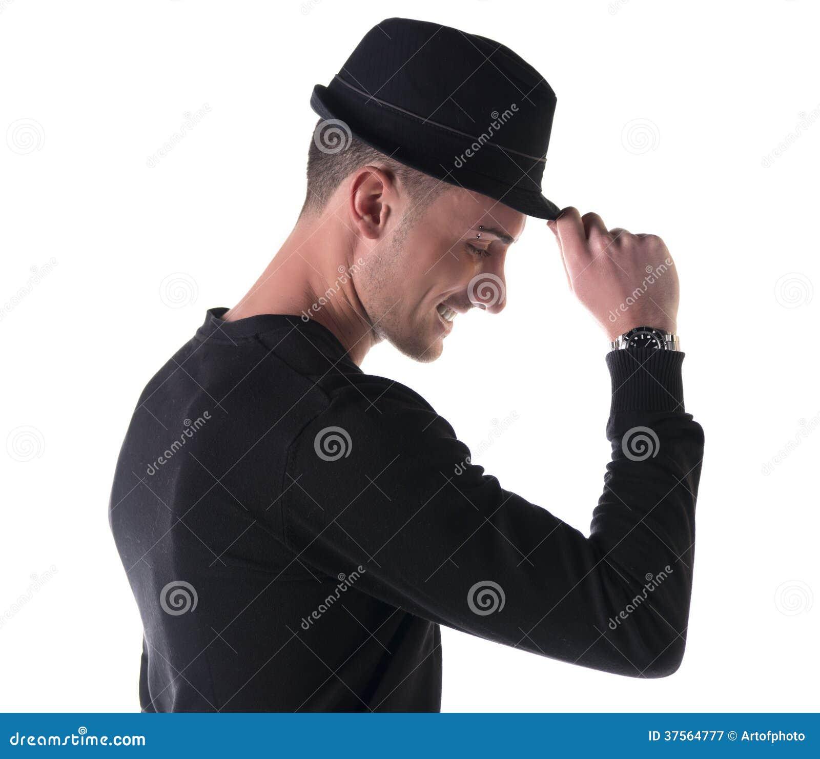 Profile Shot Of Young Man Smiling, Touching Fedora Hat ...