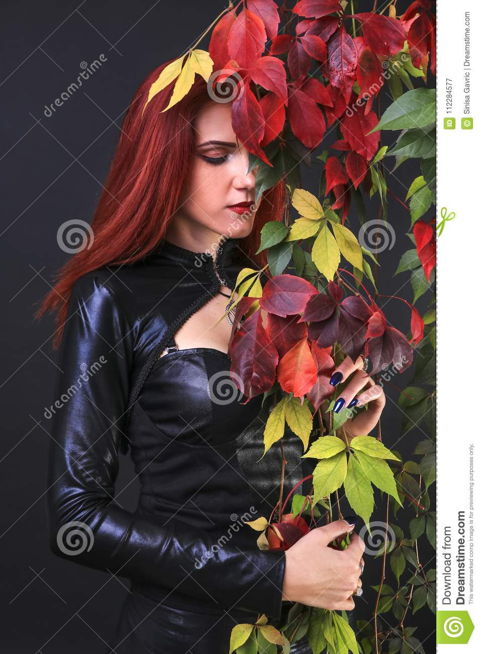Profile Of A Tall Red Head Gothic Woman Among The Autumn Vines