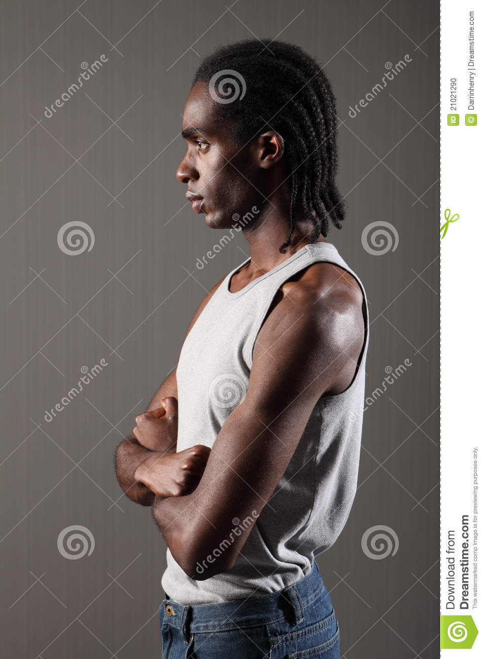Profile Of Tough Young Black Man With Dreadlocks Stock Photo