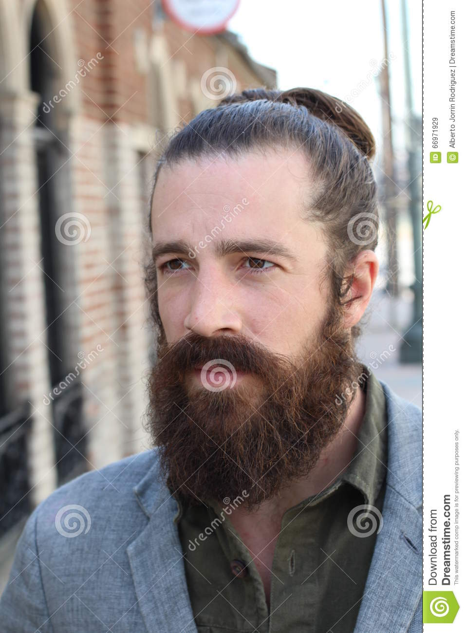 Profile Of Young Bearded Man With Man Bun And A Very Nice