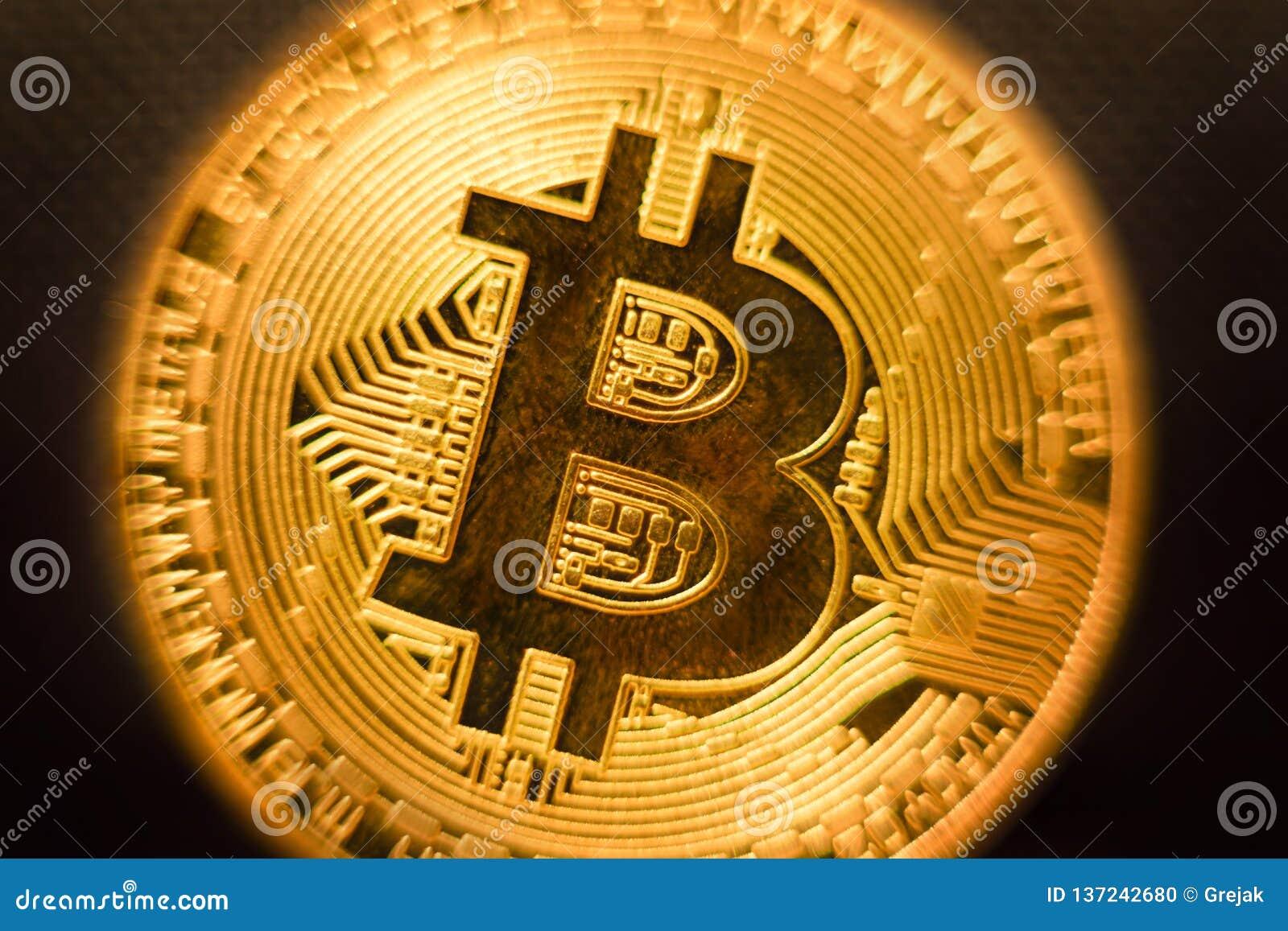 Profundidad baja del primer de la moneda de oro de Bitcoin del campo dof