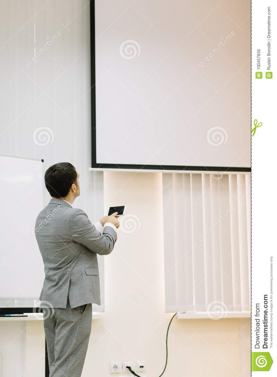 Business man showing presentation on a multimedia projector background. Technology concept. Copy space.