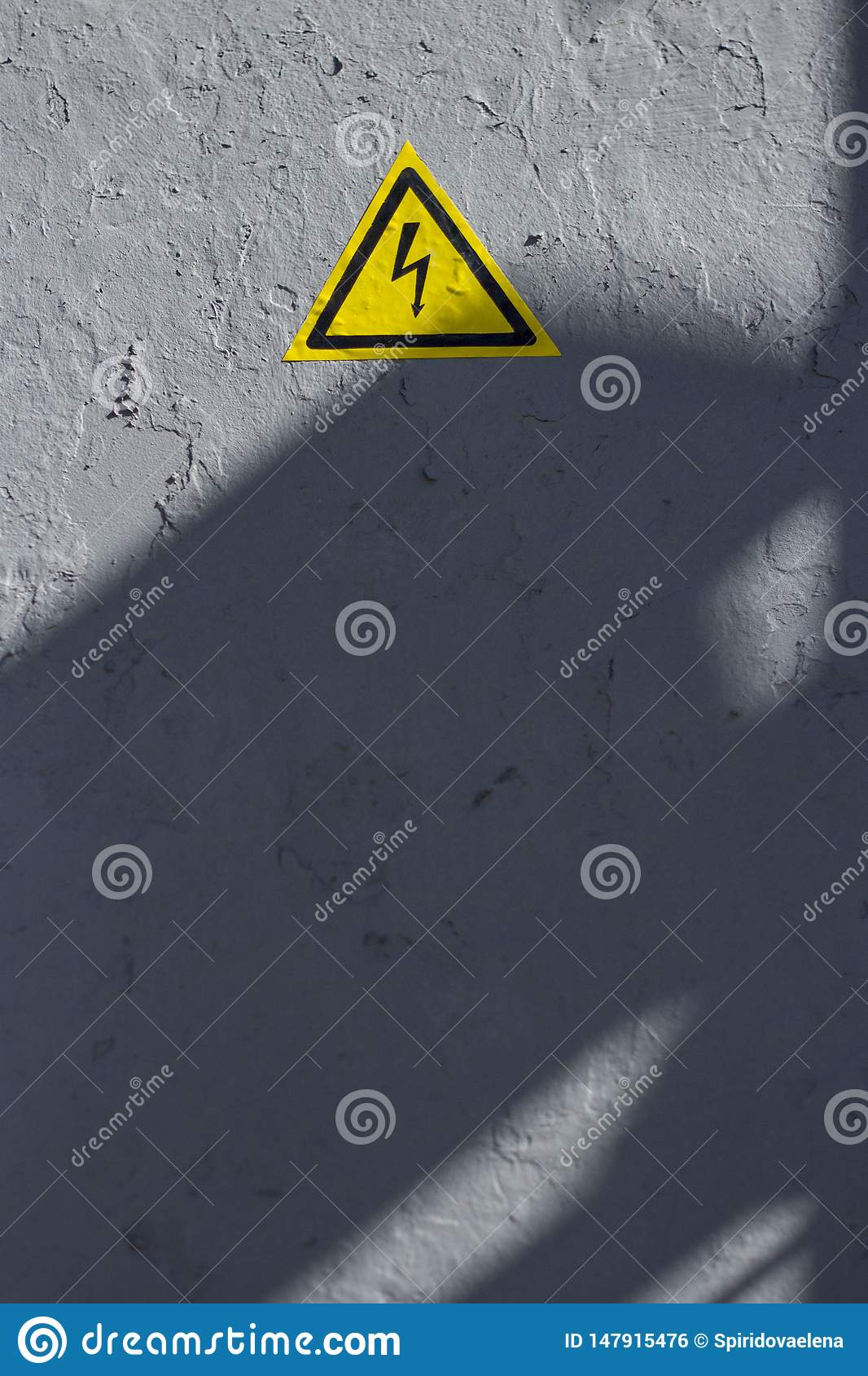 Cracked gray paint with perceiving yellow triangle icon