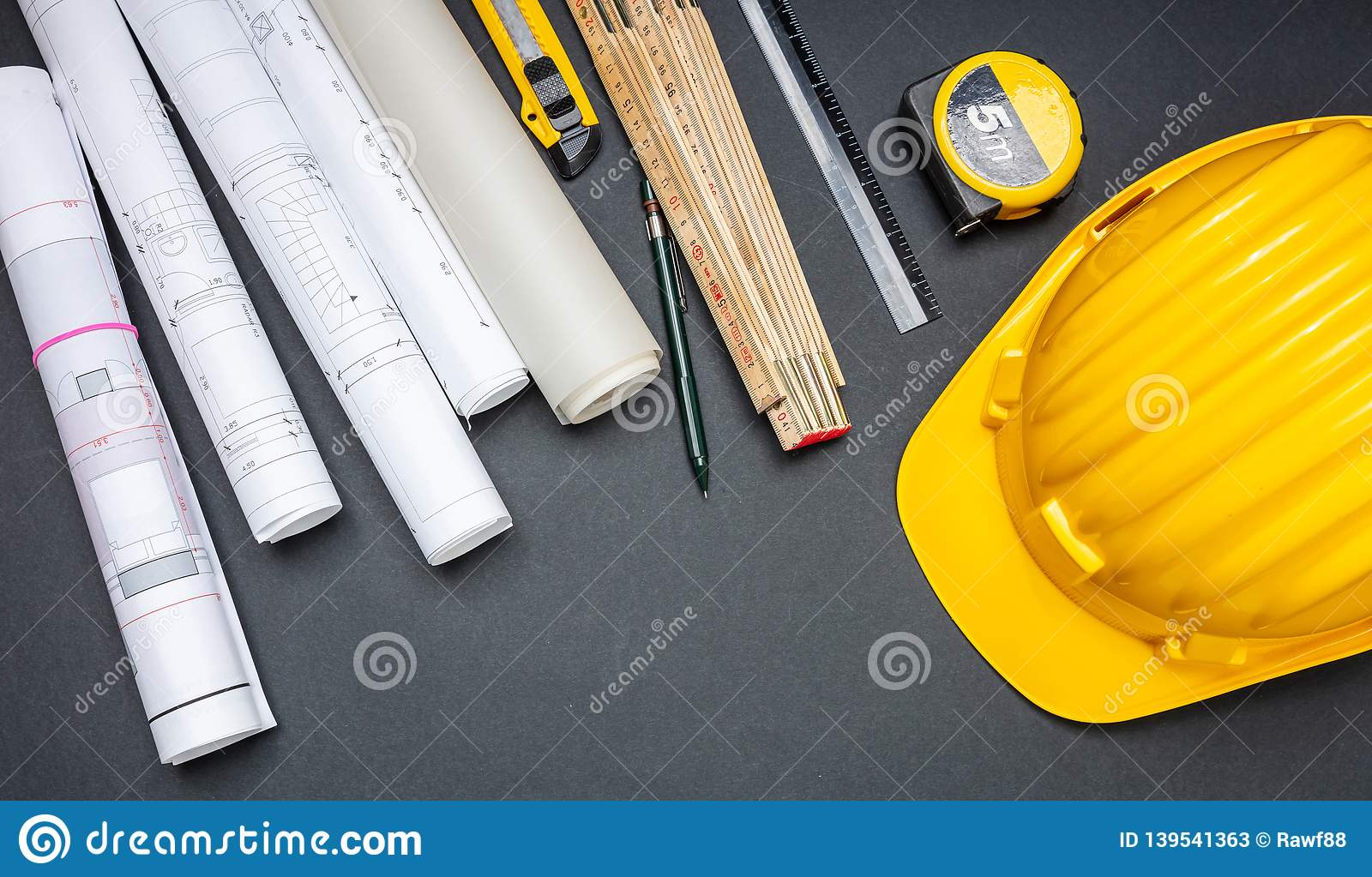 Project Blueprints, Yellow Hardhat And Engineering Tools On