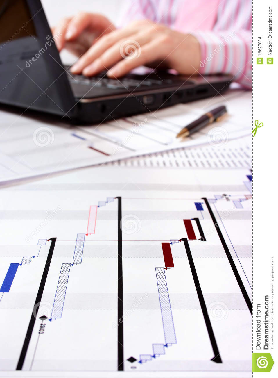project gantt chart with laptop in background stock photo