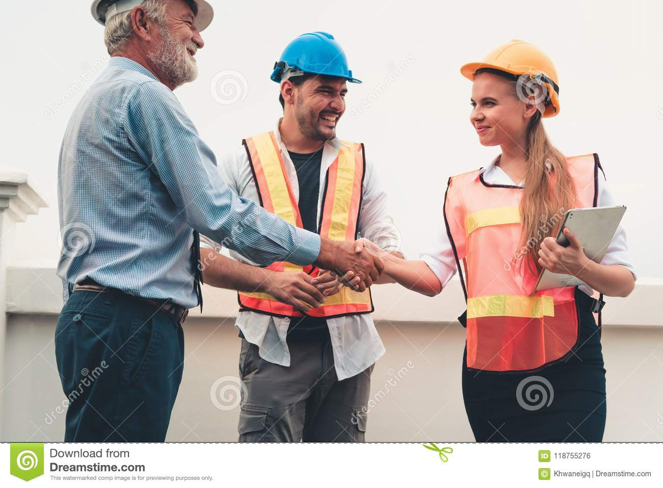 Project management team of engineers and architects are handshake together after dealing their project, Business construction con