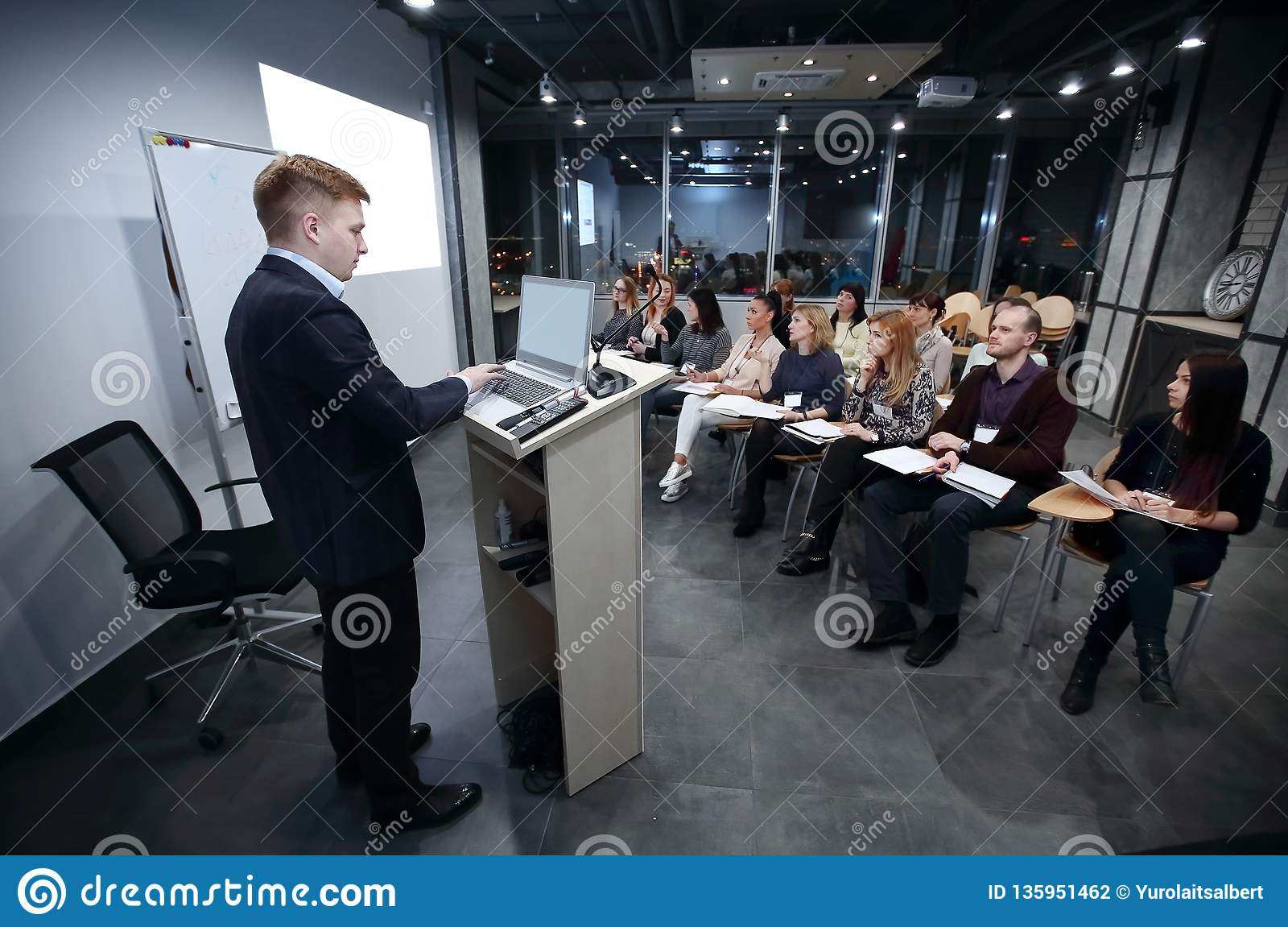 Project Manager conducts a meeting of senior staff.
