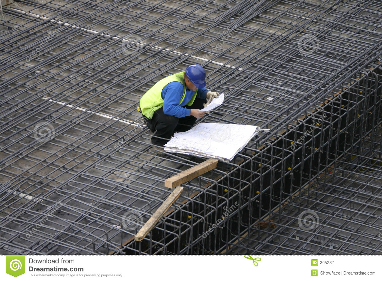 Project Manager reading the site plans