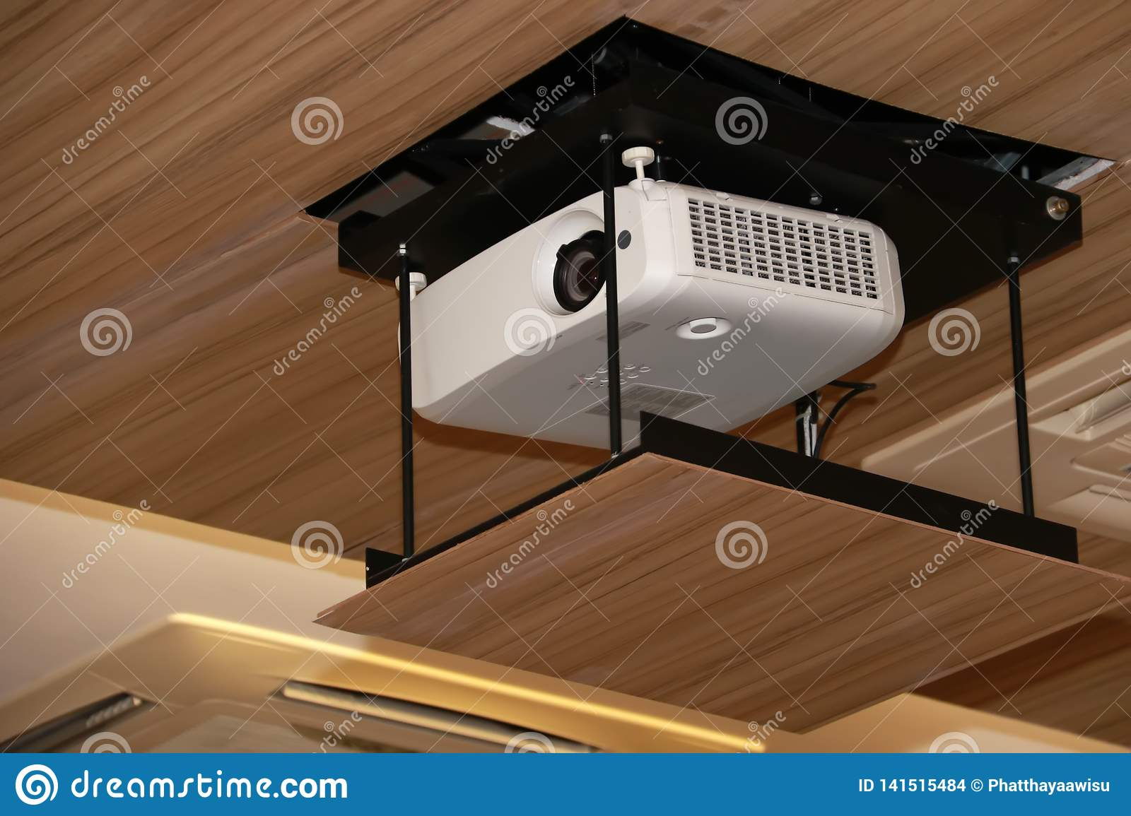 Projector hanging on meeting room ceiling