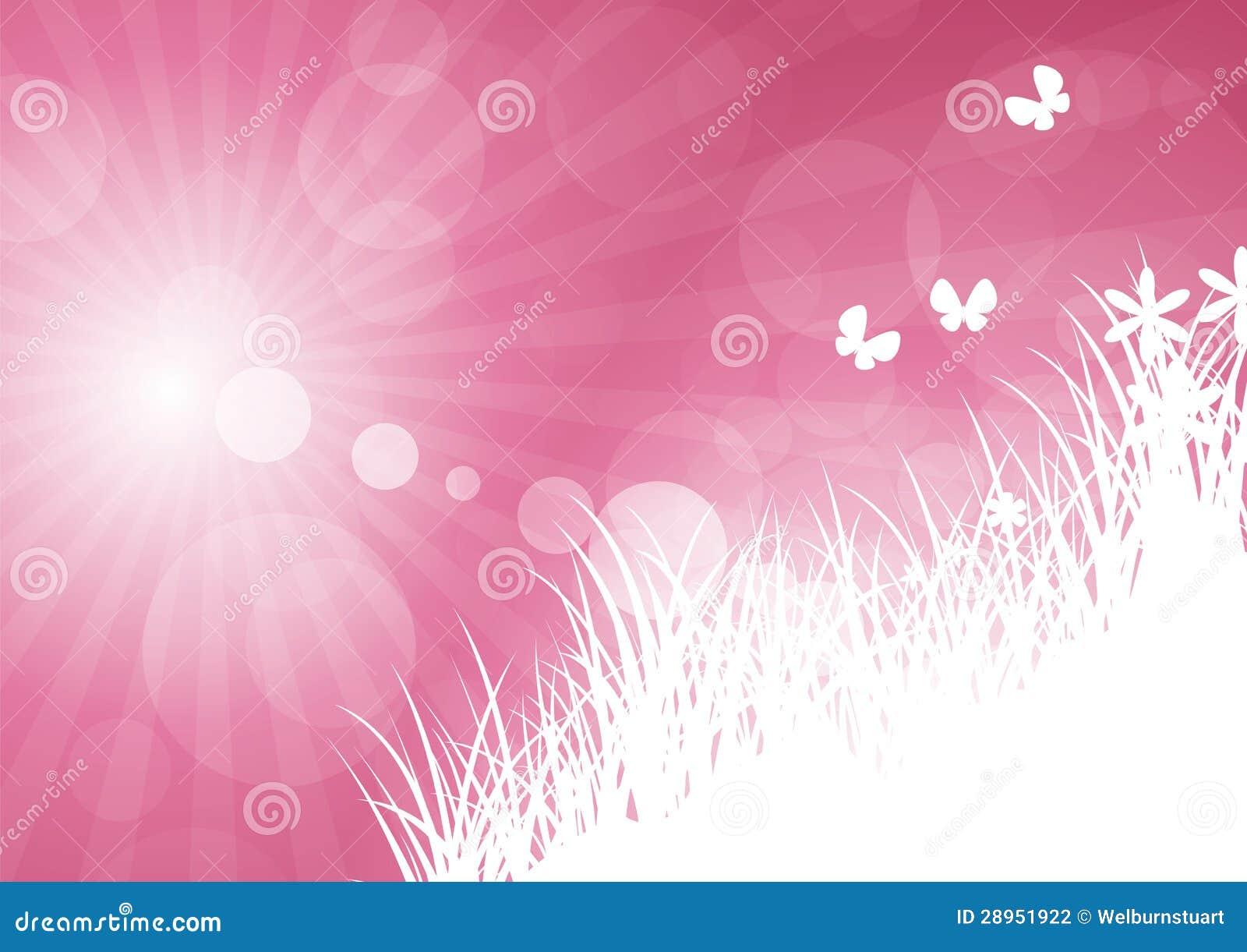 Promienie różowią z trawą