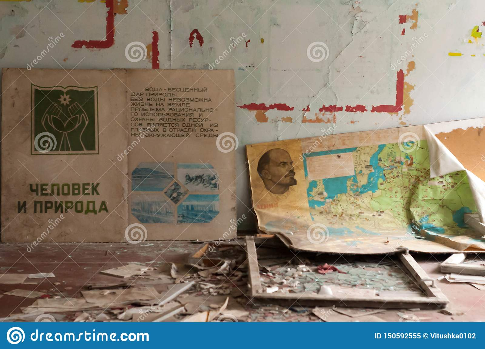 propaganda posters with Lenin and other Bolshevik and communist leaders on floor near walls in abandoned school Pripyt
