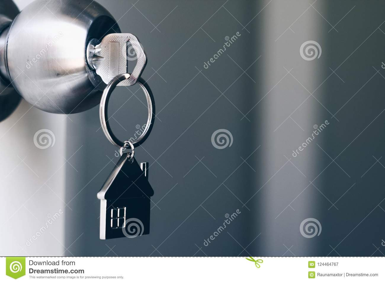 Property Concept, Home key with metal house keychain in keyhole