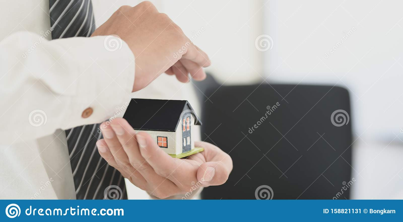 Insurance Agent Holding A House Model In His Hand, Symbol ...