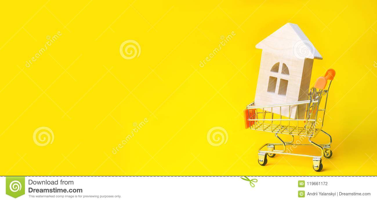 Property investment and house mortgage financial concept. buying, renting and selling apartments. real estate. Wooden house in a S