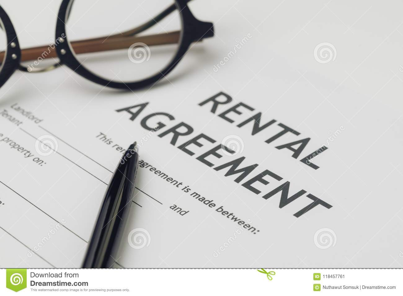 Property or real estate, house and home concept, pen and eyeglasses on rental agreement printed document, ready to sign contract