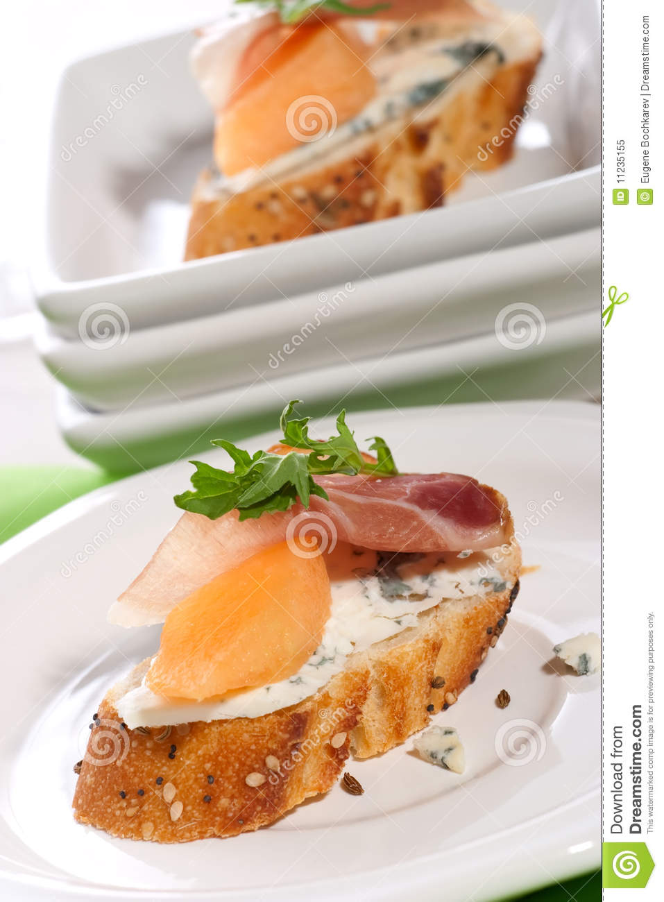Prosciutto and blue cheese canapes royalty free stock for Blue cheese canape