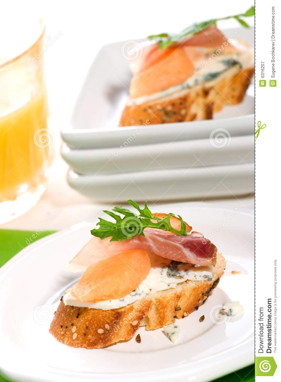 Prosciutto and blue cheese canapes royalty free stock for Prosciutto and melon canape