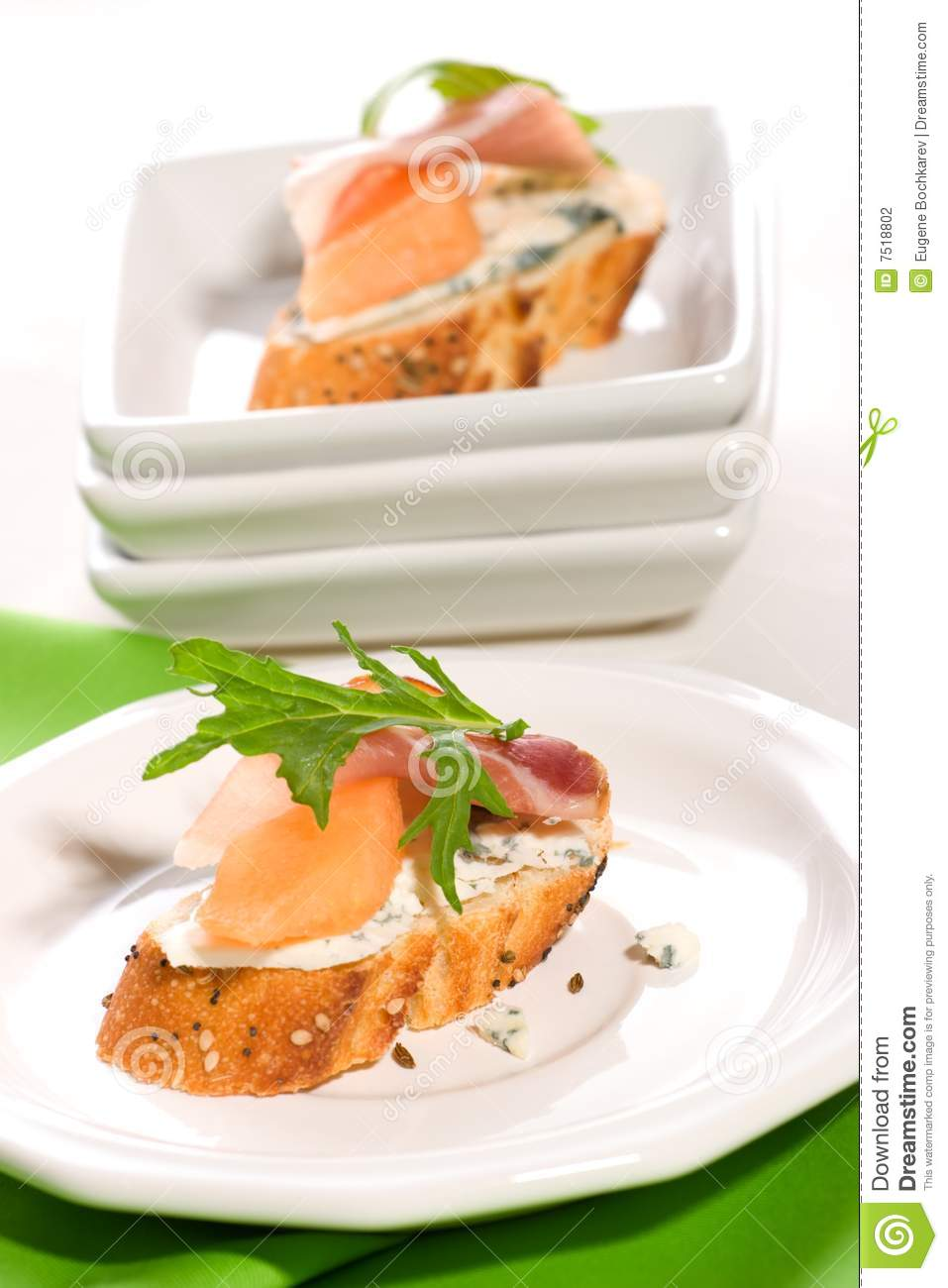 Prosciutto and blue cheese canapes stock photography for Blue cheese canape