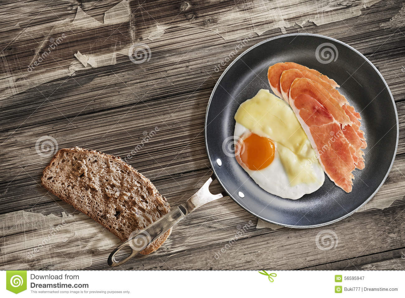 Prosciutto Rashers With Fried Egg In Frying Pan With Slice