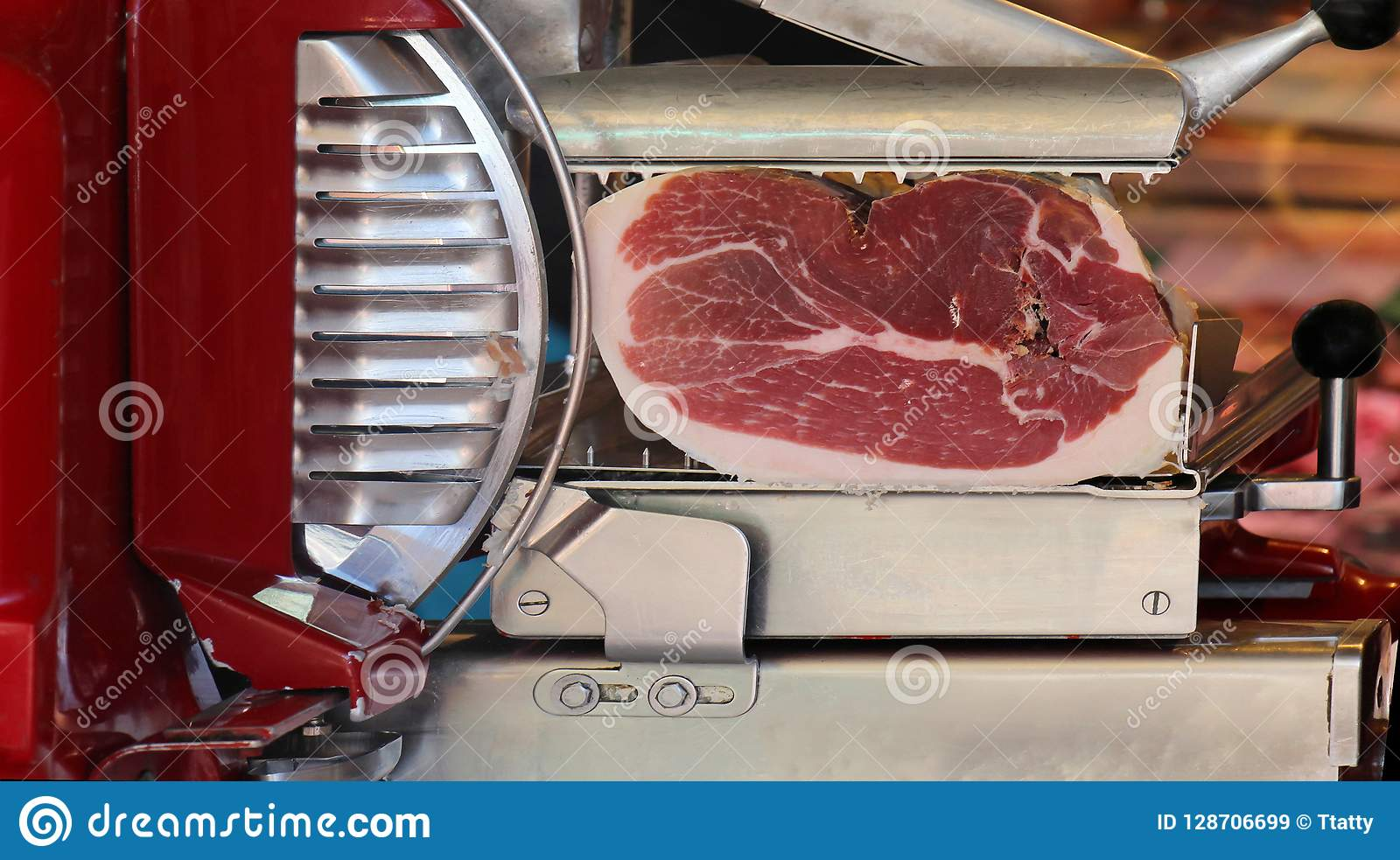 Prosciutto Slicer On Market Stock Image - Image of cured