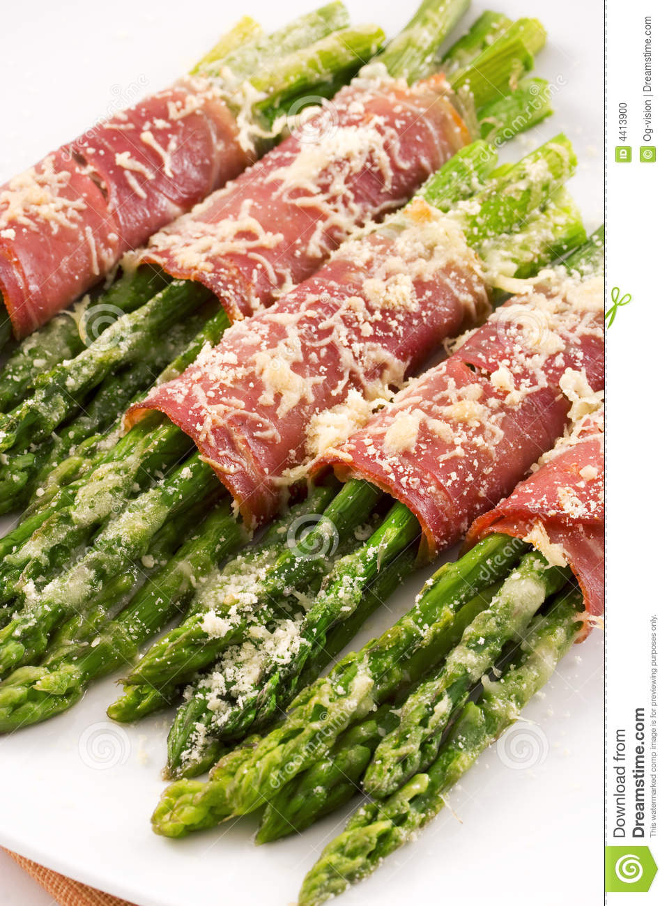 Prosciutto wrapped asparagus with parmesan cheese.