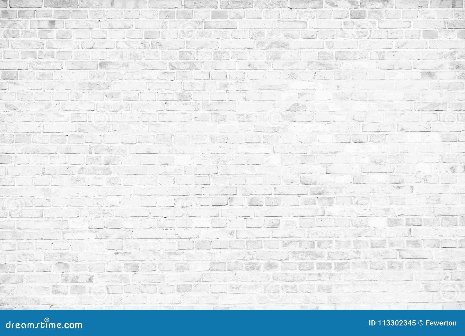 Prosty grungy biały ściana z cegieł jako bezszwowy deseniowy tekstury tło